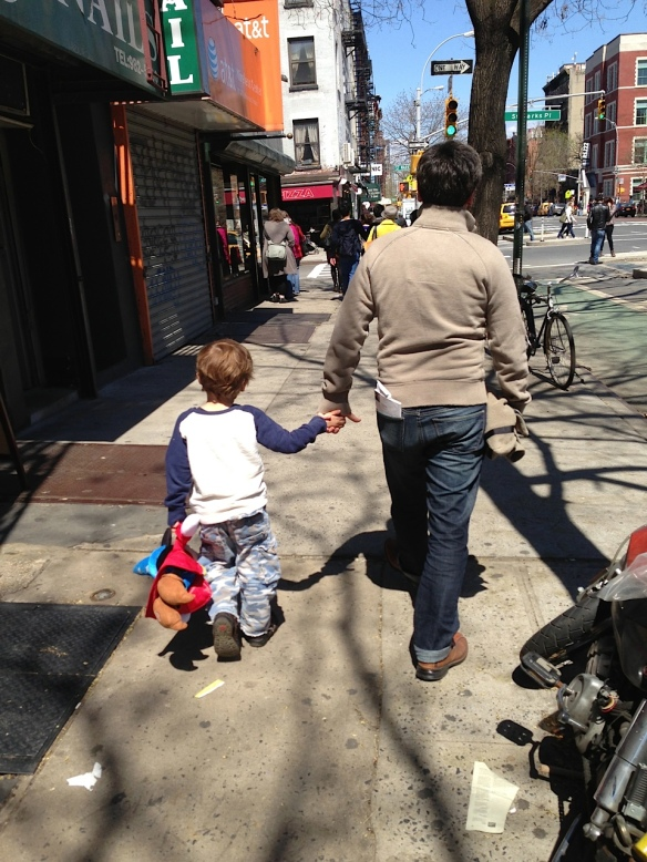After we returned to New York, Martin enjoyed carrying his Mickey Mouse doll, as here on the Lower East Side with Adrian.