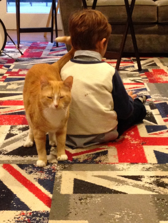 Martin, assisted by his partner-in-crime, George the Cat, plays in our family room.