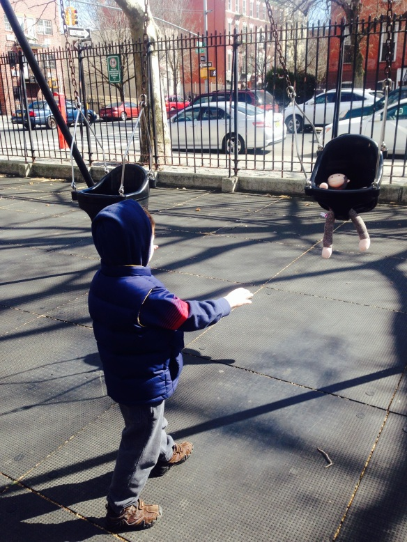 """Martin plays this weekend in Bedford-Stuyvesent, Brooklyn. I told him he was too big for these baby swings. He responded by putting his """"little brother Curious George"""" in for a ride."""