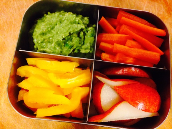 Martin's school lunch today: a dippin' plate with carrots, yellow bell pepper, avocado-and-fermented-garlic dip, and pear.
