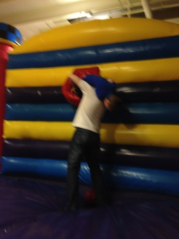 A blurry action shot: Adrian and Martin clowning at the birthday party. It's blurry because I was standing in the same bouncy house.