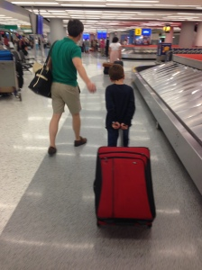 Sorry for the poor photo quality. I snapped this shot of Adrian and Martin when we returned to JFK and Martin wanted to help by pulling the big suitcase himself.
