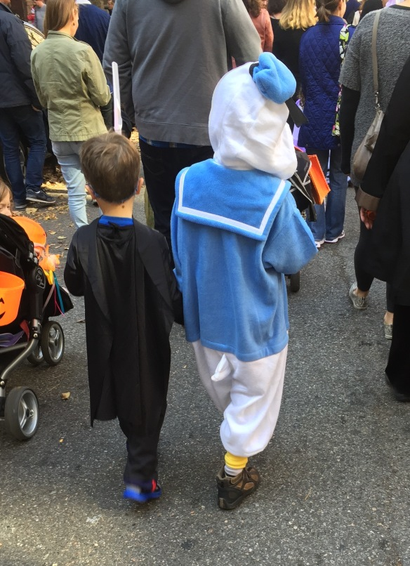 Martin, as Donald Duck, trick-or-treating with friend.